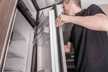 How can you keep your RV refrigerator cold when you are driving